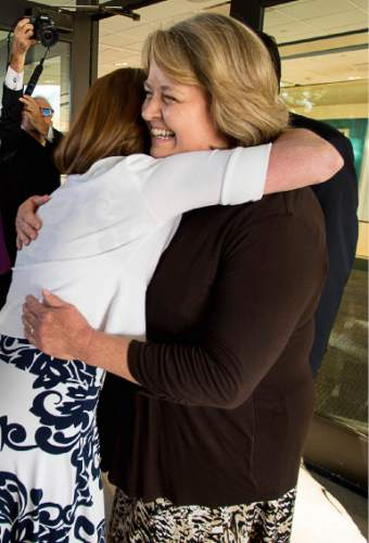 Trent Nelson  |  The Salt Lake Tribune Abby Hansen, left, embraces Karen Roberts before leading a group of women through the door of BYU's Marriott Center to watch a broadcast of the LDS General Priesthood Session, in Provo Saturday October 4, 2014. Roberts and her husband Michael were volunteer ushers at the door assigned to meet the group and discourage, but not prevent the group from attending.