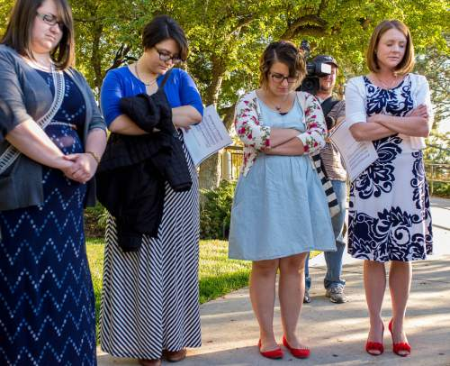 Trent Nelson  |  The Salt Lake Tribune Ellen Koester, Analisa Estrada, Cheryl Holdaway, and Abby Hansen pray before entering a broadcast of the LDS General Priesthood Session at BYU's Marriott Center in Provo Saturday October 4, 2014. The event was one of several planned by Ordain Women.