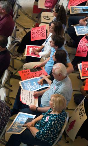 Steve Griffin  |  The Salt Lake Tribune  People hold signs in their laps as they listen to speakers during the Stand for Marriage Rally sponsored by Celebration of Marriage, Standard of Liberty, Utah Eagle Forum, United Women's Forum and Family Watch International at the Capitol in Salt Lake City, Tuesday, April 28, 2015.