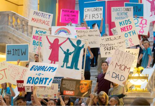 Steve Griffin  |  The Salt Lake Tribune  People hold signs during the Stand for Marriage Rally sponsored by Celebration of Marriage, Standard of Liberty, Utah Eagle Forum, United Women's Forum and Family Watch International at the Capitol in Salt Lake City, Tuesday, April 28, 2015.