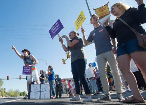 Steve Griffin  |  The Salt Lake Tribune  Same-sex marriage supporters participate in a honk and wave to support same-sex marriage arguments at the U.S. Supreme Court, outside Piper Down Pub near 1500 South and State Street in Salt Lake City, Tuesday, April 28, 2015.
