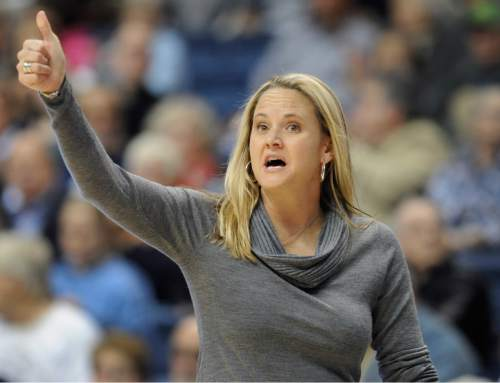 Pacific coach Lynne Roberts gestures in the first half of an NCAA college basketball game against Connecticut in Storrs, Conn., Tuesday, Nov. 15, 2011. Connecticut won 112-53. (AP Photo/Jessica Hill)