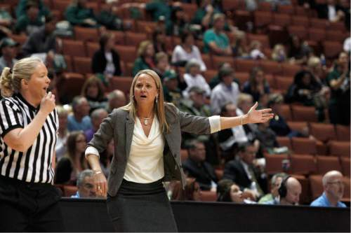 Pacific head coach Lynne Roberts shouts to an official in the first half of the NCAA Big West tournament women's championship basketball game against Cal Poly  in Anaheim, Calif., Saturday, March 16, 2013. (AP Photo/Reed Saxon)