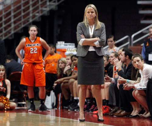 Pacific head coach Lynne Roberts, front right, and the bench watch the final minute of their 63-49 loss to Cal Poly in the NCAA Big West tournament women's championship basketball game in Anaheim, Calif., Saturday, March 16, 2013. (AP Photo/Reed Saxon)