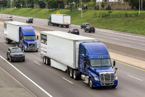 Courtesy  |  Peloton Technology  Trucks follow each other closely to draft off each other to save fuel and cut emissions. New technology to allow such platooning by trucks communicating with each other will soon be tested on rural Utah highways, thanks to a new bill.