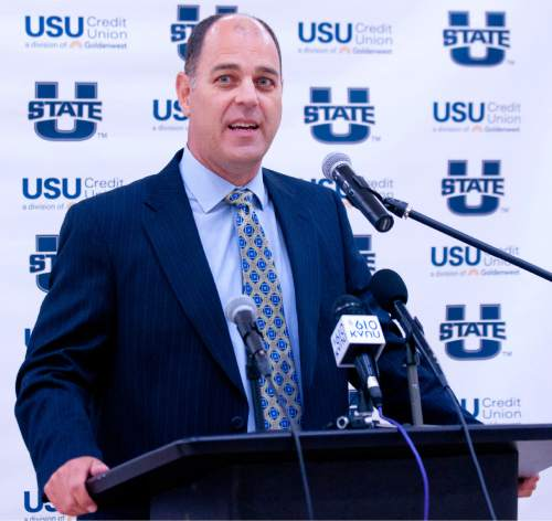 Tim Duryea, the newly named head Utah State men's basketball coach, speaks during a press conference in the Estes Center on Monday morning. (John Zsiray/Herald Journal)