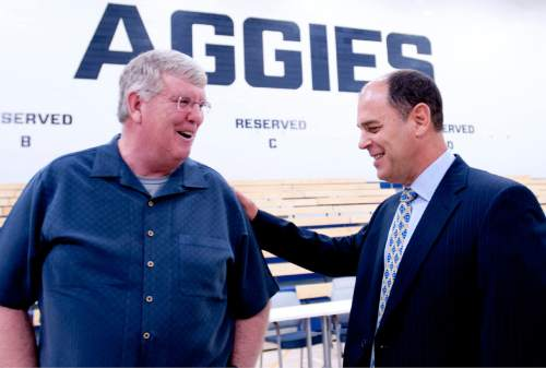 Former Utah State basketball coach Stew Morrill shares a laugh with his longtime assistant Tim Duryea after Duryea was announced as the head coach of the program on Monday morning. (John Zsiray/Herald Journal)