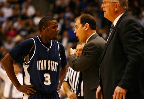 Djamila Grossman  |  The Salt Lake Tribune  Utah State University's coach Tim Duryea talks to Brockeith Pane, 3, at a game against Brigham Young University in Provo, Thursday, Nov. 17, 2010. BYU won the game.