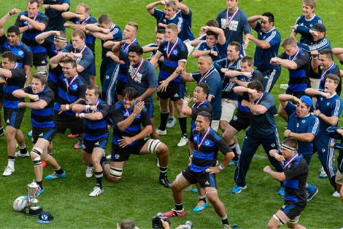 Trent Nelson  |  The Salt Lake Tribune BYU rugby players celebrate their national championship after defeating Cal in the Penn Mutual Varsity Cup National Rugby Championship at Rio Tinto Stadium in Sandy, Saturday May 2, 2015.