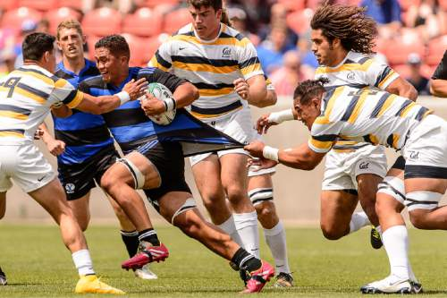 Trent Nelson  |  The Salt Lake Tribune BYU's Ara Elkington (7) gets tangled up as BYU faces Cal in the Penn Mutual Varsity Cup National Rugby Championship at Rio Tinto Stadium in Sandy, Saturday May 2, 2015.
