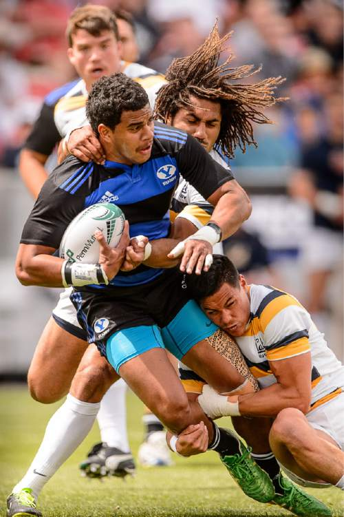Trent Nelson  |  The Salt Lake Tribune BYU's Josh Whippy (13) is brought down as BYU faces Cal in the Penn Mutual Varsity Cup National Rugby Championship at Rio Tinto Stadium in Sandy, Saturday May 2, 2015.