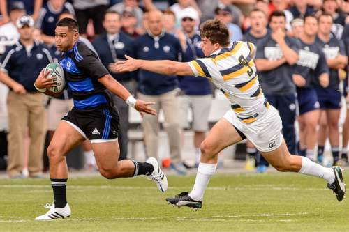 Trent Nelson  |  The Salt Lake Tribune BYU's Seki Kofe (12) runs to score a try as BYU faces Cal in the Penn Mutual Varsity Cup National Rugby Championship at Rio Tinto Stadium in Sandy, Saturday May 2, 2015.