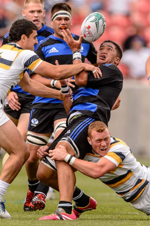 Trent Nelson  |  The Salt Lake Tribune Players grapple for the ball as BYU faces Cal in the Penn Mutual Varsity Cup National Rugby Championship at Rio Tinto Stadium in Sandy, Saturday May 2, 2015.