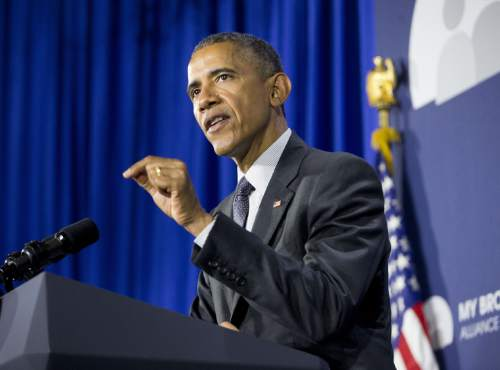 """President Barack Obama gestures as he speaks at Lehman College in the Bronx borough of New York, Monday, May 4, 2015. Obama announced the creation of an independent nonprofit organization that is a spin off his """"My Brother's Keeper"""" program, which works to give young men of color more opportunities through mentoring and business partnerships. (AP Photo/Pablo Martinez Monsivais)"""
