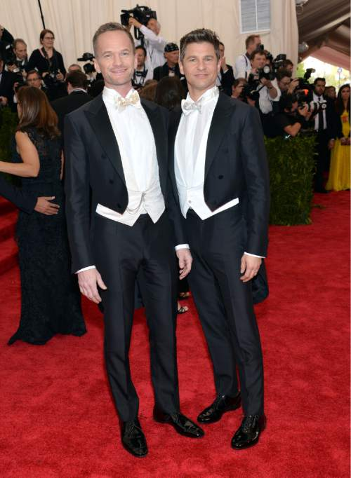 """Neil Patrick Harris, left, and David Burtka arrive at The Metropolitan Museum of Art's Costume Institute benefit gala celebrating """"China: Through the Looking Glass"""" on Monday, May 4, 2015, in New York. (Photo by Evan Agostini/Invision/AP)"""