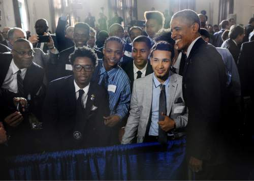 Students pose with President Barack Obama at the launch of My Brother's Keeper Alliance at Lehman College in the Bronx borough of New York, Monday, May 4, 2015. My Brother's Keeper Alliance is an outgrowth of Obama's year-old My Brother's Keeper initiative, which has focused on federal government policies and grants designed to increase access to education and jobs. (Susan Watts/The Daily News via AP, Pool)
