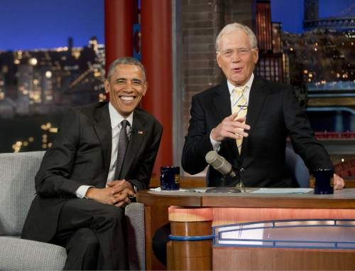 """President Barack Obama with host David Letterman talk during a break at a taping of CBS' The Late Show with David Letterman at the Ed Sullivan Theater in New York, Monday, May 4, 2015. Obama traveled to New York to announced the creation of an independent nonprofit organization that is a spinoff his """"My Brother's Keeper"""" program, to tape a segment on Letterman's show and to do fundraising for the Democratic party. (AP Photo/Pablo Martinez Monsivais)"""