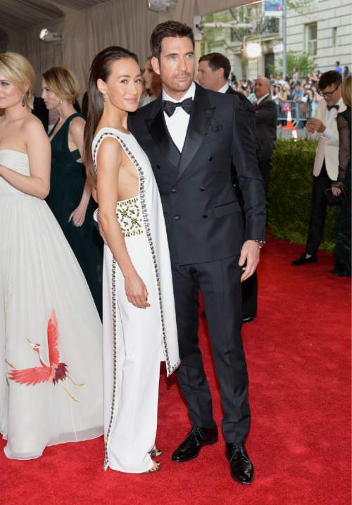 """Maggie Q, left, and Dylan McDermott arrive at The Metropolitan Museum of Art's Costume Institute benefit gala celebrating """"China: Through the Looking Glass"""" on Monday, May 4, 2015, in New York. (Photo by Evan Agostini/Invision/AP)"""
