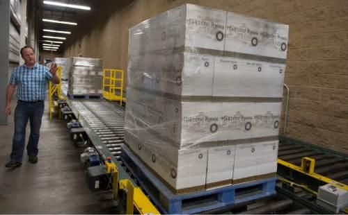 Rick Egan  |  The Salt Lake Tribune  Cade Meier, Warehouse General Manager, explains the Automated Storage Retrieval System at the DABC liquor warehouse, Thursday, April 30, 2015.