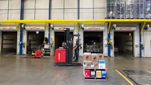 Rick Egan  |  The Salt Lake Tribune  Workers load orders into the trucks at the picking warehouse at the DABC liquor warehouse, Thursday, April 30, 2015.