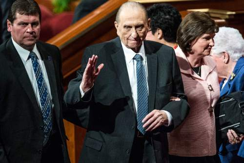 Chris Detrick  |  The Salt Lake Tribune LDS Church President Thomas S. Monson waves to the crowd with his daughter Ann M. Dibb during the 185th Annual LDS General Conference Saturday April 4, 2015.