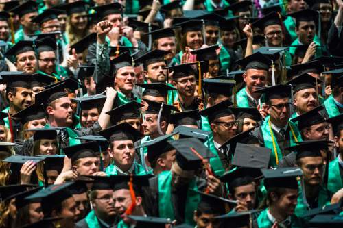 Chris Detrick  |  The Salt Lake Tribune Students cheer after graduating at Utah Valley University's Commencement Ceremonies at the UCCU Events Center Thursday April 30, 2015.
