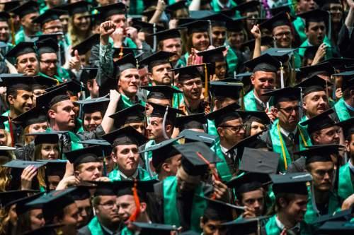 Chris Detrick  |  The Salt Lake Tribune Students cheer after graduating at Utah Valley University's Commencement Ceremonies at the UCCU Events Center Thursday April 30, 2015.