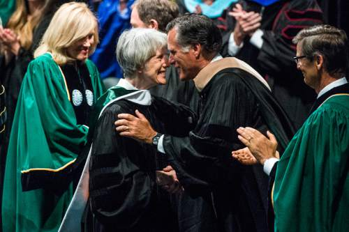 Chris Detrick  |  The Salt Lake Tribune Mitt Romney greets Pamela J. Atkinson after receiving an Honorary Doctorate of Law during Utah Valley University's Commencement Ceremonies at the UCCU Events Center Thursday April 30, 2015.