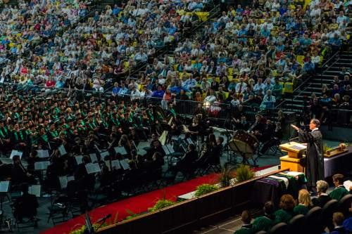Chris Detrick  |  The Salt Lake Tribune Mitt Romney speaks during Utah Valley University's Commencement Ceremonies at the UCCU Events Center Thursday April 30, 2015.