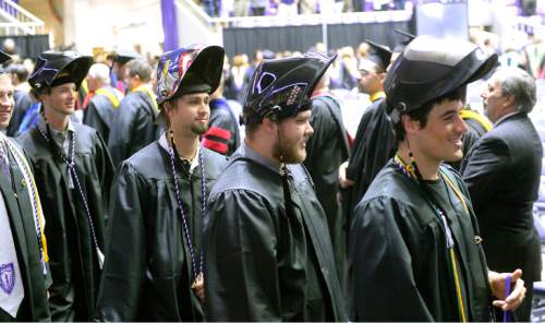 Al Hartmann  |  The Salt Lake Tribune Weber State University graduates walk in procession into the Dee Events Center Friday May 1 for the 145th commencement excercise.  It is the largest graduating class.