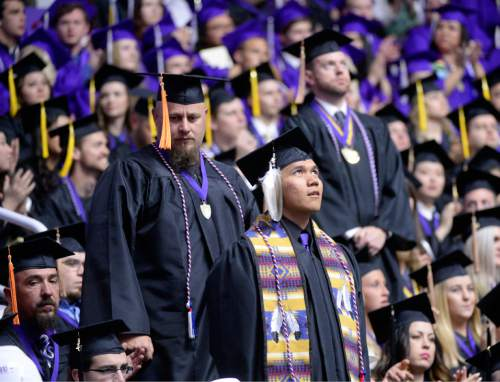 Al Hartmann  |  The Salt Lake Tribune Weber State University graduates that serve in the U.S military services rise to be recognized Friday May 1 for the 145th commencement excercise at the Dee Event Center.   It is the largest graduating class.