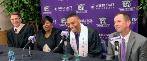 Al Hartmann  |  The Salt Lake Tribune Damian Lillard, point guard for the Portland Trail Blazers, center, answers questions at a press conference at the Dee Events Center  before he received his diploma at Weber State commencement ceremony.   Left is his academic advisor Carl Grunander and his mother Gina Johnson.   Weber basketball coach Randy Rahe, right.    Lillard is graduating with a degree in professional sales. He  was six credits shy of graduating when he was drafted in 2012, but polished off his classes in the offseason.