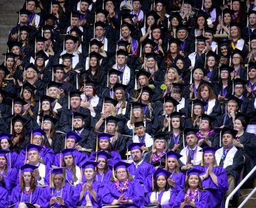 Al Hartmann  |  The Salt Lake Tribune Some of the Weber State University graduates applaud in the Dee Events Center Friday May 1 for the 145th commencement excercise.  It is the largest graduating class.