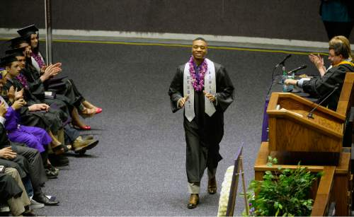 Al Hartmann  |  The Salt Lake Tribune Damian Lillard, point guard for the Portland Trail Blazers, walks across floor of Dee Events Center Friday May 1 to finally graduate and receive his diploma. He  was six credits shy of graduating when he was drafted in 2012, but polished off his classes in the offseason.