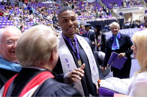 Al Hartmann  |  The Salt Lake Tribune Damian Lillard, point guard for the Portland Trail Blazers, signs autographs and mingles with Weber State University faculty at the Dee Events Center Friday May 1 where he finally graduated and received his diploma. He was six credits shy of graduating when he was drafted in 2012, but polished off his classes in the offseason.