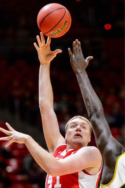 Trent Nelson  |  The Salt Lake Tribune Utah Utes forward Jeremy Olsen (41) shoots over Alabama State Hornets center Robert Ojeah (45) as the University of Utah Utes host the Alabama State Hornets, college basketball at the Huntsman Center in Salt Lake City, Saturday November 29, 2014.