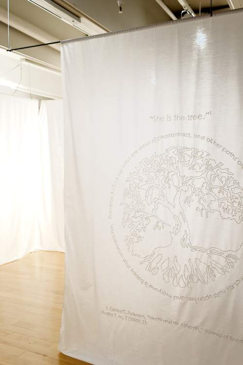 "Courtesy photo Katie West Payne's art exhibit, ìA Space for the Contemplation of a Sacred Silence,"" includes panels of white fabric containing hand-embroidered symbols and words about Mormonism's Mother in Heaven: a tree, representing her as wisdom; a trinity knot, representing the godhead; the famous Utah symbol of a beehive, to portray Heavenly Mother as the queen bee; and a bird from ìAre You My Mother?î a childrenís book by P.D. Eastman."