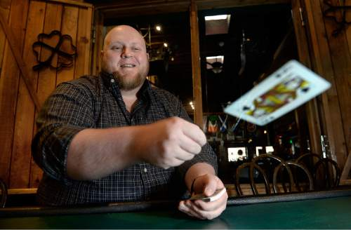 Scott Sommerdorf   |  The Salt Lake Tribune Piper Down Co-Poker Director Les Pendergraft deals cards for a portrait at Piper Down, Tuesday, April 21, 2015.