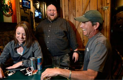 Scott Sommerdorf   |  The Salt Lake Tribune Piper Down Co-Poker Director Les Pendergraft interacts with players during a tournament at Piper Down, Tuesday, April 21, 2015.