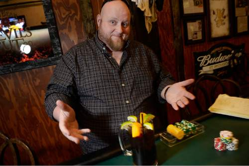 Scott Sommerdorf   |  The Salt Lake Tribune Piper Down Co-Poker Director Les Pendergraft with his preferred drink - Coca-Cola with limes and lemons - at Piper Down, Tuesday, April 21, 2015.