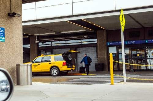 Chris Detrick  |  The Salt Lake Tribune A taxi drops off a customer at the Salt Lake City International Airport Wednesday May 6, 2015.