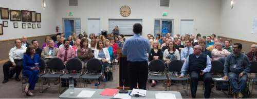 Steve Griffin  |  The Salt Lake Tribune  Parents, teachers and administrators listen as representatives from the Utah State Office of Education hold an informational meeting on the new Science Core Standards in Provo, Utah Wednesday, May 6, 2015.