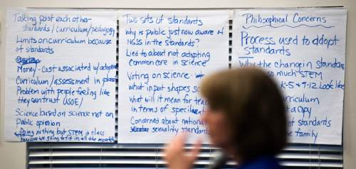 Steve Griffin  |  The Salt Lake Tribune  Syd Dickson, deputy superintendent of the Utah State Office of Education, front, stands in front of sheets of paper used to write down concerns from parents, teachers and administrators as representatives from the Utah State Office of Education during an informational meeting on the new Science Core Standards in Provo, Utah Wednesday, May 6, 2015.