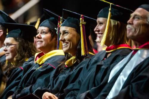 Chris Detrick     The Salt Lake Tribune Graduate students listen during the University of Utah Commencement Ceremony at the Jon M. Huntsman Center Thursday May 7, 2015.