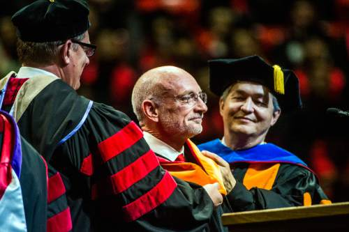 Chris Detrick  |  The Salt Lake Tribune Mark Fuller, CEO of WET, receives an honorary degree in engineering during the University of Utah Commencement Ceremony at the Jon M. Huntsman Center Thursday May 7, 2015.