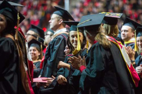 Chris Detrick  |  The Salt Lake Tribune Masters students cheer during the University of Utah Commencement Ceremony at the Jon M. Huntsman Center Thursday May 7, 2015.