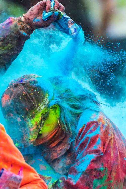 Chris Detrick  |  The Salt Lake Tribune Revelers throw colored powder during the 4th Annual Festival of Colors at the Krishna Temple in Salt Lake City Saturday May 9, 2015.