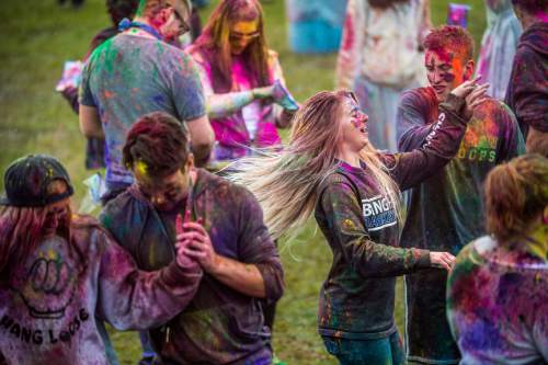 Chris Detrick  |  The Salt Lake Tribune Revelers dance during the 4th Annual Festival of Colors at the Krishna Temple in Salt Lake City Saturday May 9, 2015.