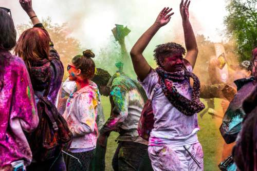 Chris Detrick  |  The Salt Lake Tribune Revelers dance and throw colored powder during the 4th Annual Festival of Colors at the Krishna Temple in Salt Lake City Saturday May 9, 2015.