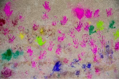 Chris Detrick  |  The Salt Lake Tribune Hand prints on a wall from revelers during the 4th Annual Festival of Colors at the Krishna Temple in Salt Lake City Saturday May 9, 2015.